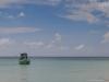 Boat at wild sandy beach